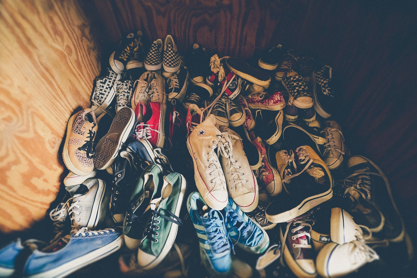untidy space full with trainers
