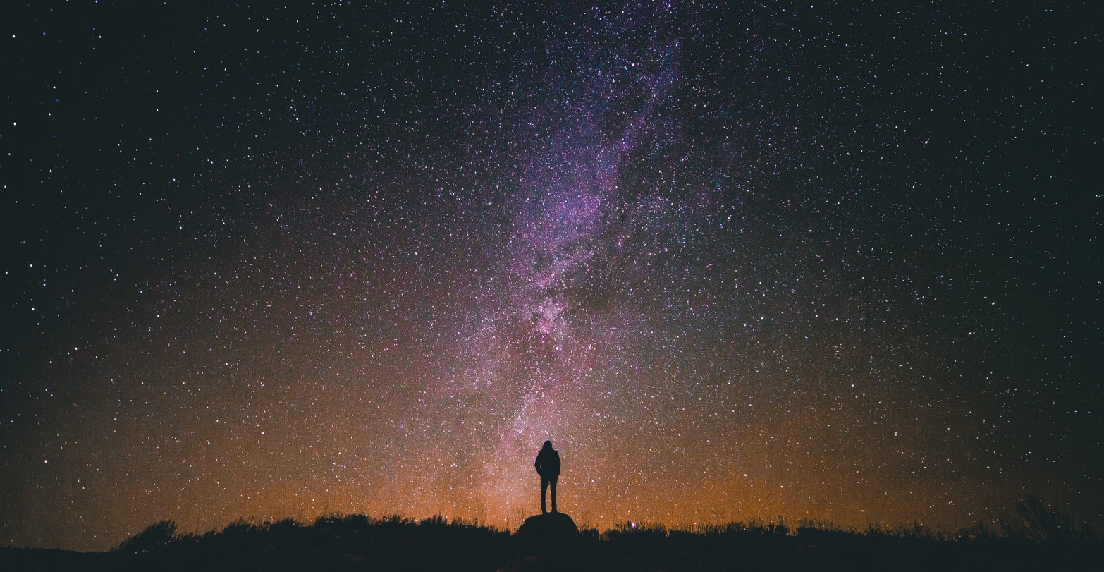 girl looking at the universe and the starry sky