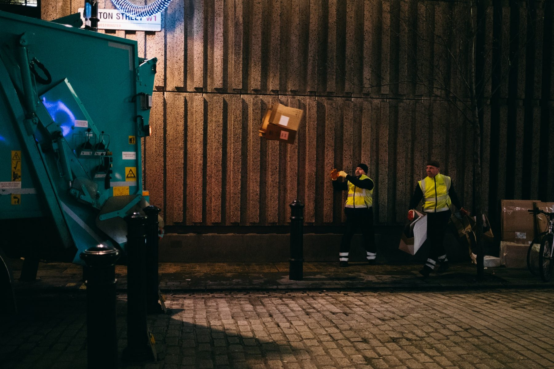 people throwing away garbage