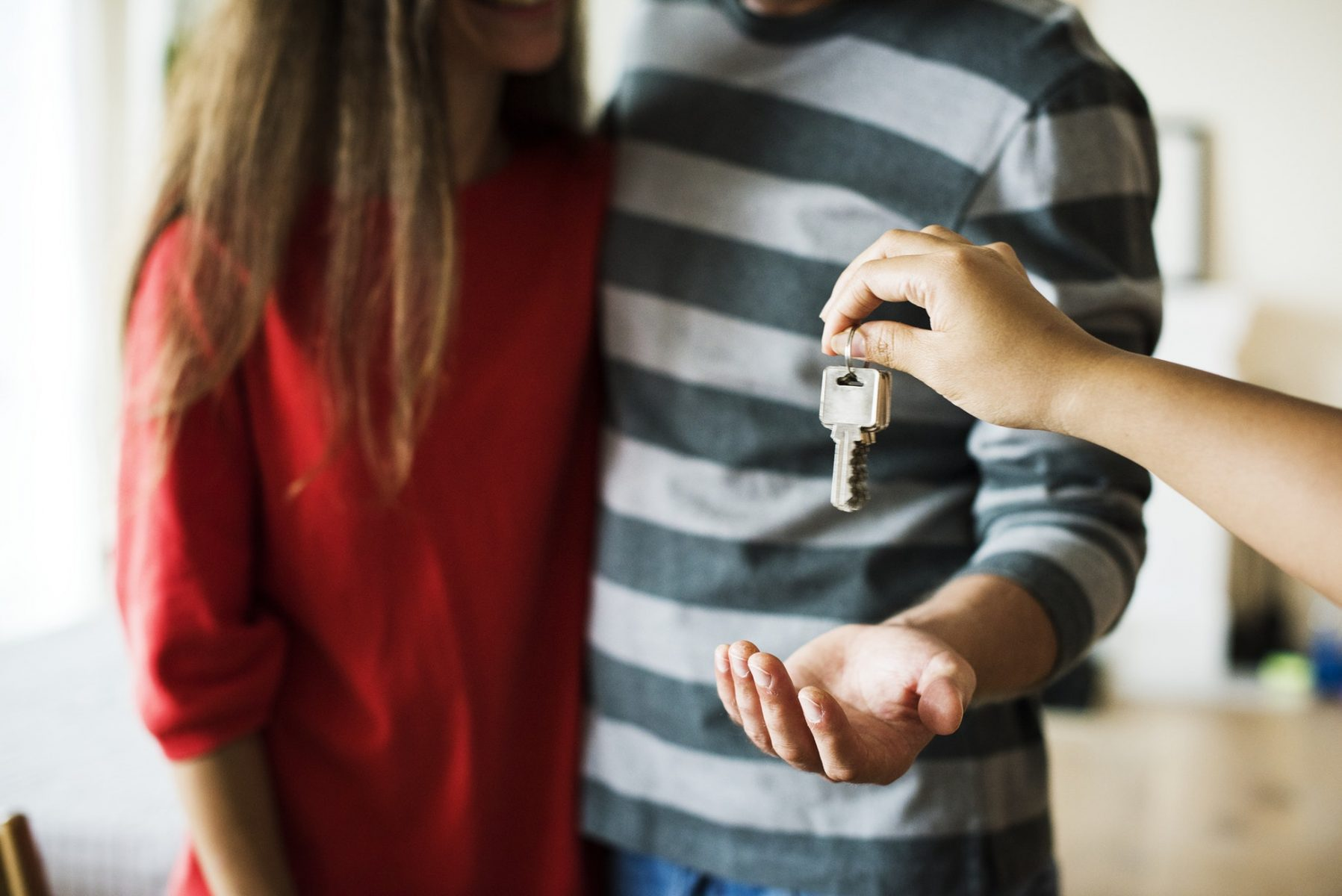 couple receiving the keys of their apartment