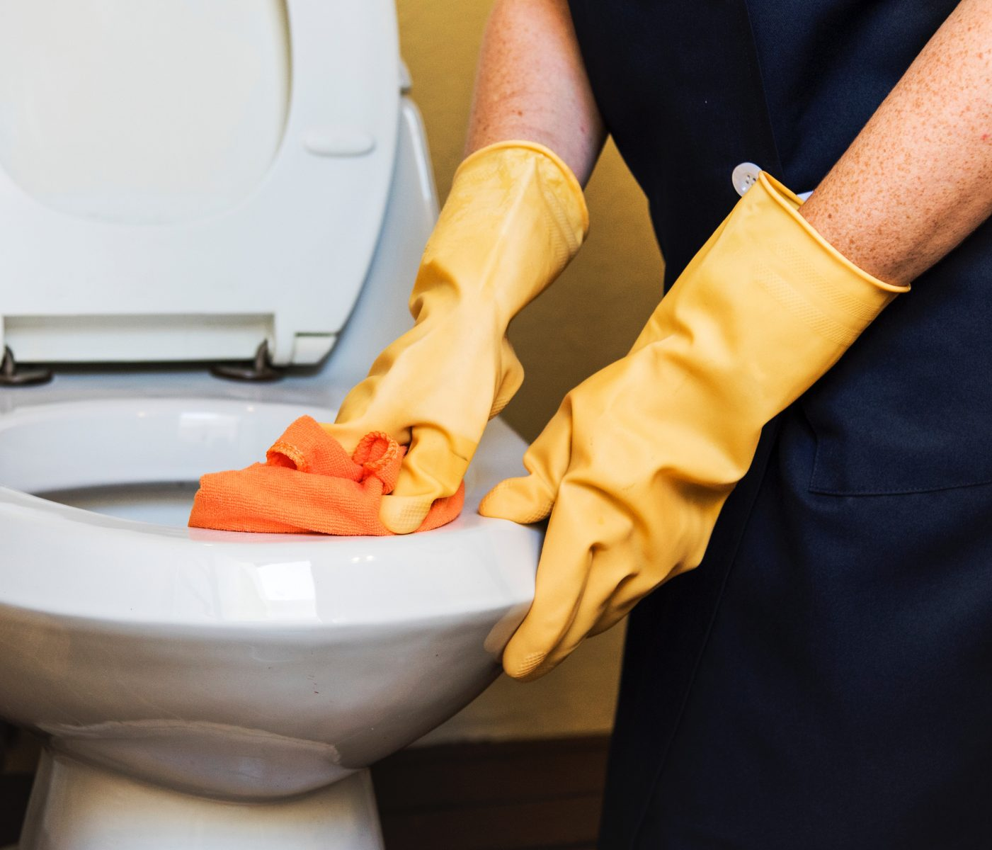 toilet cleaning, yellow rubber gloves